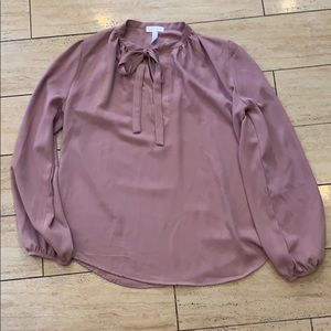 Dusty pink blouse with front tie detail.